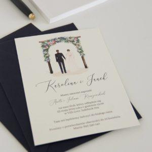 Akwarelowe zaproszenia ślubne z sylwetką młodej pary pod kwiatową altaną